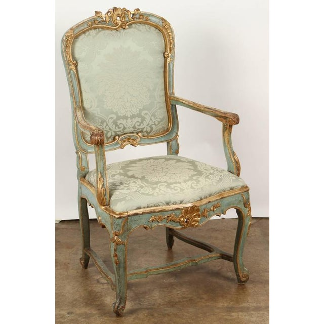 The chair, upholstered with matching silk damask to the seat and back rest, the slightly rounded crestrail decorated with...