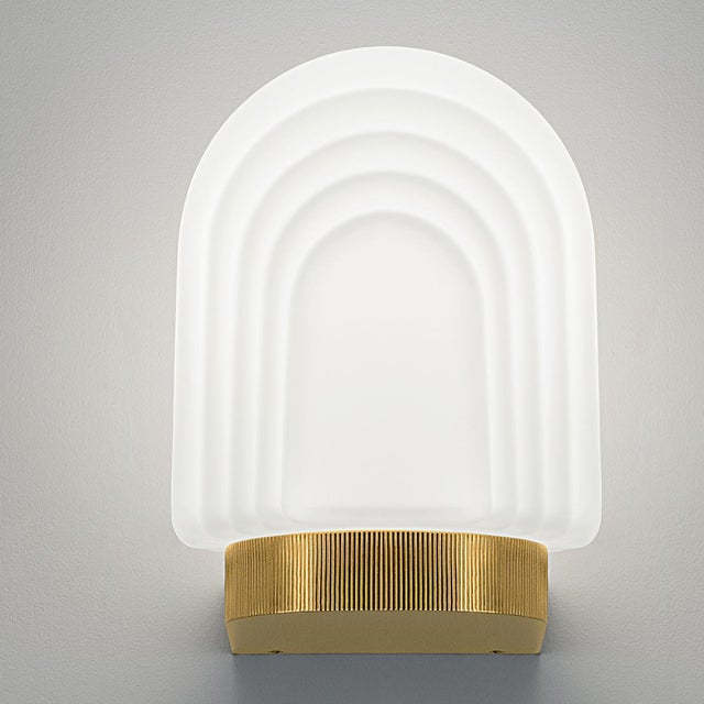 An art deco style bathroom wall light in brushed brass with mouthblown glass. Certification: IP44 (zone 2). We recommend...