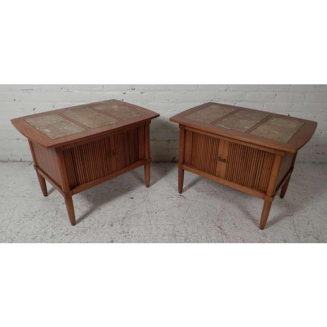 Pair of vintage modern end tables with three panel marble tops. Tambour door cabinet with brass hardware. Wear consistent...
