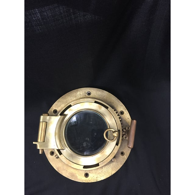 """Solid brass, operational porthole window. Really fantastic nautical touch, with great patina. 11.5"""" diameter 5.5"""" deep"""