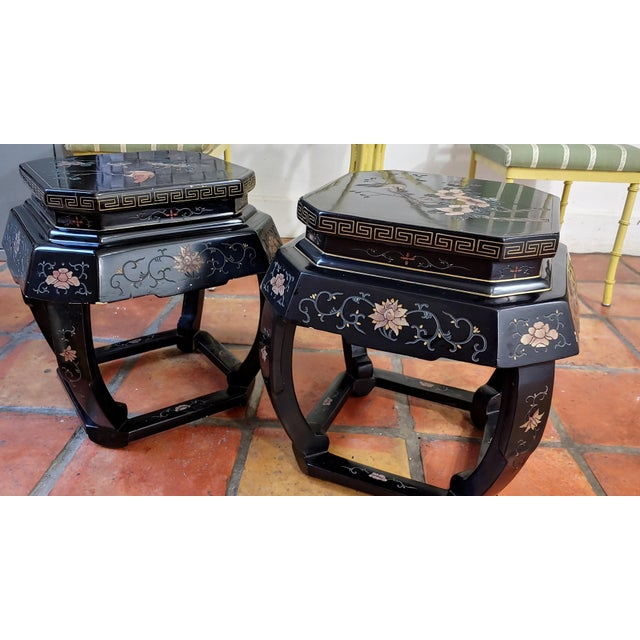 Sold separately, 2 available. Charming pair of uniquely shaped asian tables with canter corners. Bird and branch is...