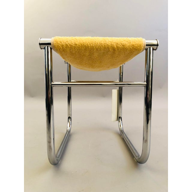 A chrome steel trivalent frame bathroom stool (LC9) with butter cream colored towelling. Designed by Le Corbusier, Pierre...