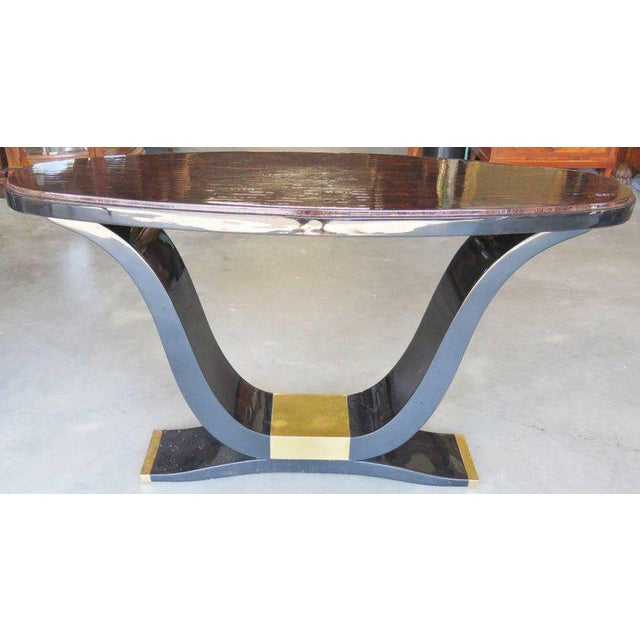 """Tassellated horn with heavily lacquered finish. Beveled glass mirror. Mirror measures 48 1/2""""diameter."""