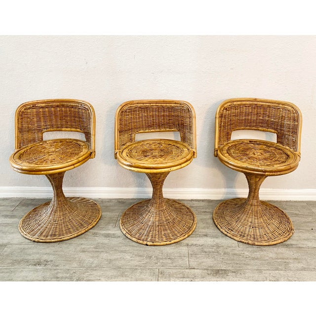 Set of 1960's Danny ho Fong woven rattan swivel chairs. Sturdy and strong. I. Like new condition.