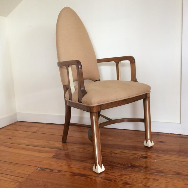 A stylish single armchair from the late 1920's. with tall arched back and sinuous lines. Possibly designed by Joseph...