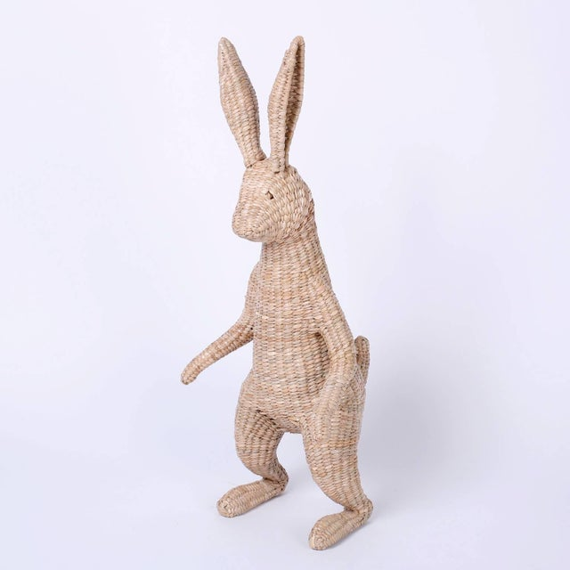 Midcentury rabbit with an amusing fairy tale inspired presence. Constructed with wicker reed over a metal frame. Signed...