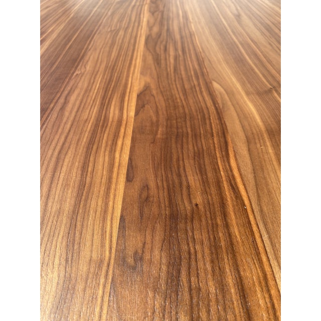 A luxurious rectangular walnut veneer dining table made in Italy makes a grand impression in a modern dining room. With a...