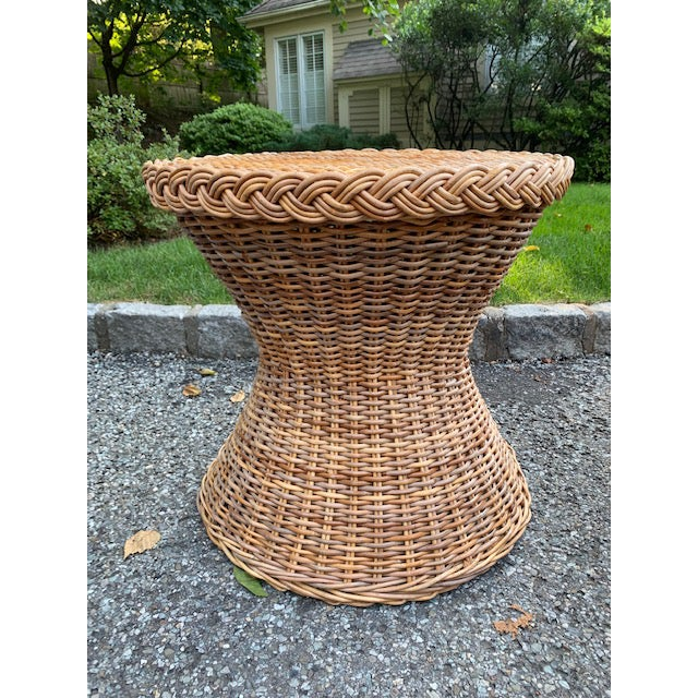 Sturdy vintage wicker table in an hourglass shape. Perfect as is or a glass table top can be added. Great condition! No...