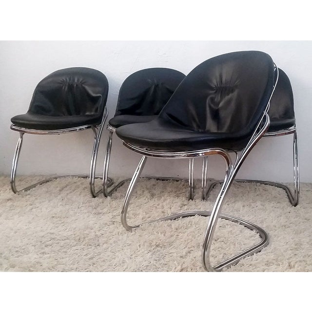 Available right now VVLA has an incredible set of 4 Gastone Rinaldi basket chrome dining chairs! The chairs all have their...