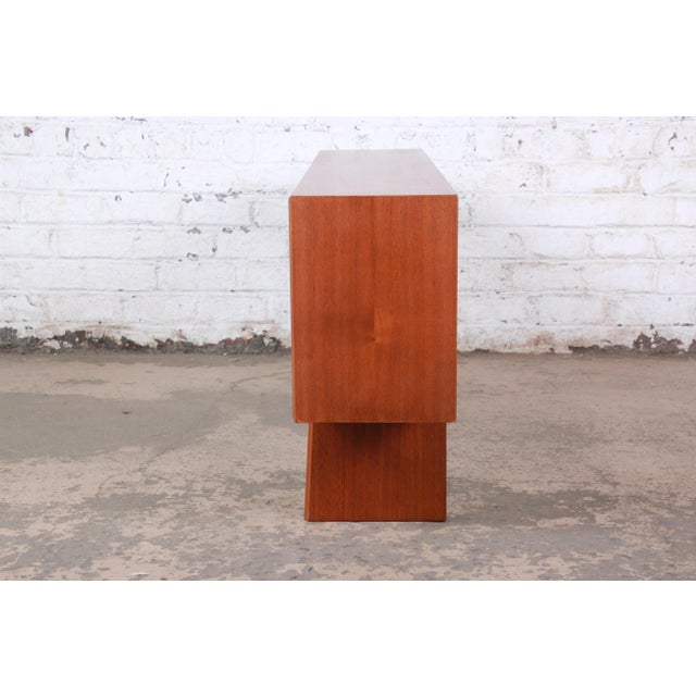 An exceptional mid-century Danish Modern teak glass front bookcase or credenza designed by Svend Aage Larsen for Faarup...