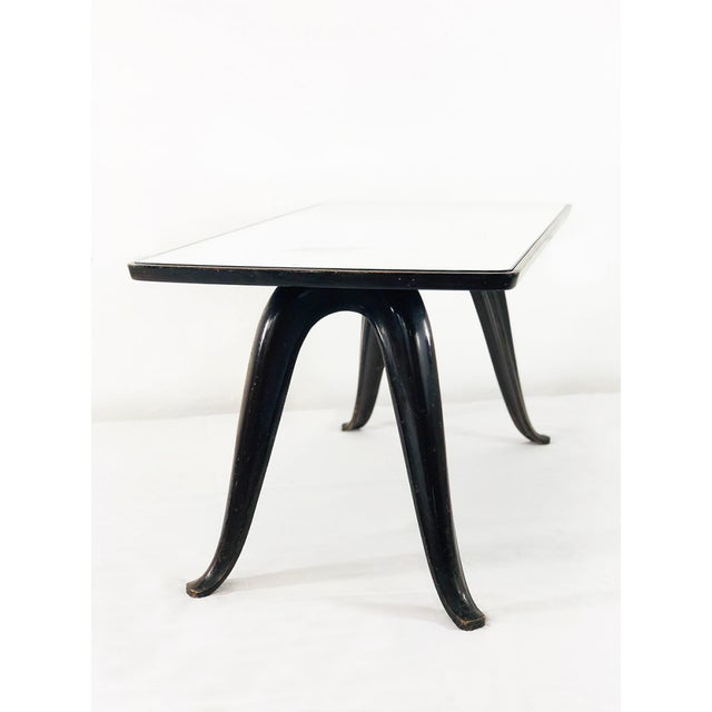 Pietro chiesa small table for fontanaarte of 1941. Pietro chiesa's small table is made of wood and its shelf is mirrored....