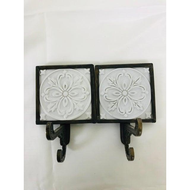 1990s brass & white decorative ceramic tile wall mounted hooks. Great details on hooks & tile.