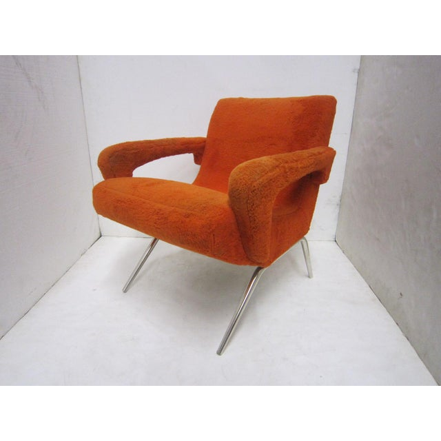 A gorgeous pair of highly architectural and sculptural vintage Italian armchairs. The angular arms extend from the...