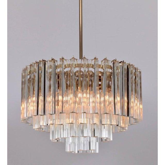 Wonderful multi-level Murano Triedri glass chandelier from the 1960s by Venini. The chandelier brings a wonderful...