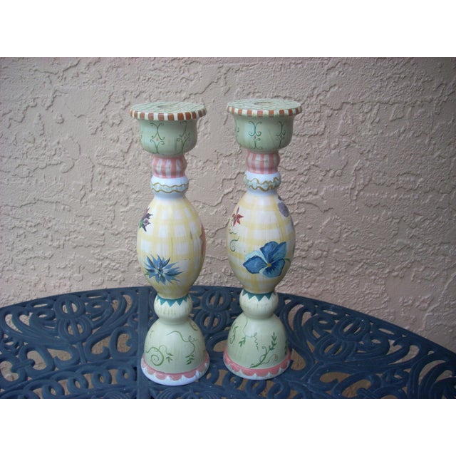 Vintage manufactured by Stonehouse Farm Goods; signed by the artist; slightly different design on each candlestick; Tracy...