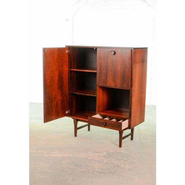 This beautiful high quality finished mid-century Dutch design rosewood cabinet is made by Fristho Franeker. It features a...