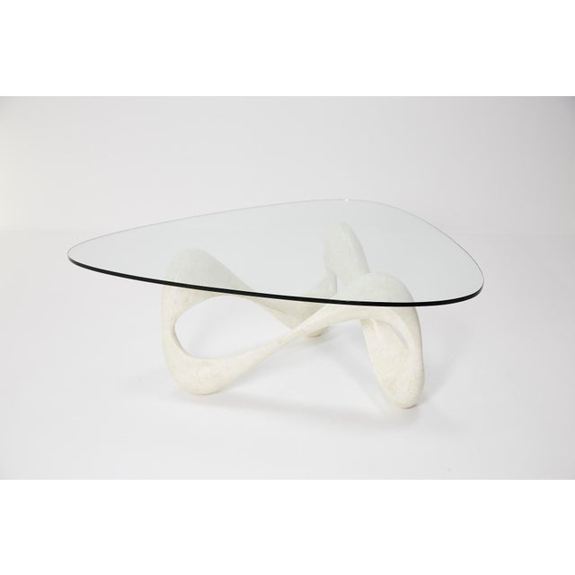 """Simple and minimal freeform """"Cursive"""" white tessellated stone base supports a soft triangular shaped, beveled glass top...."""