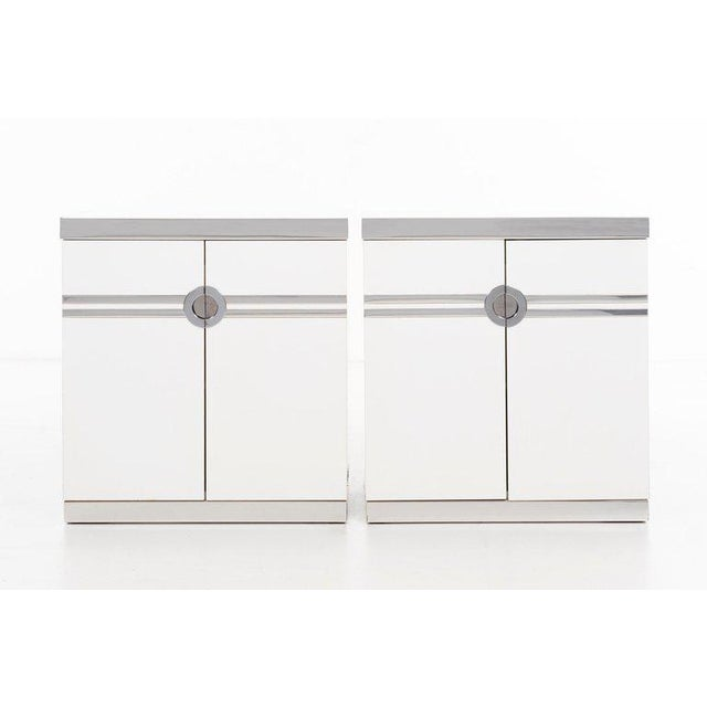 Pierre Cardin (b. 1922) Pair of laminate-clad nightstands with chromed hardware and details, featuring an interior pull-...