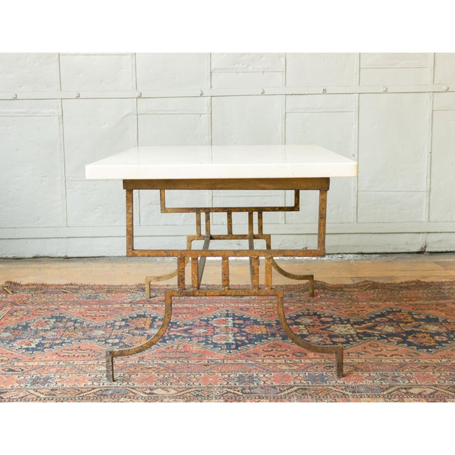Gilt iron coffee table with marble top. French 1940s