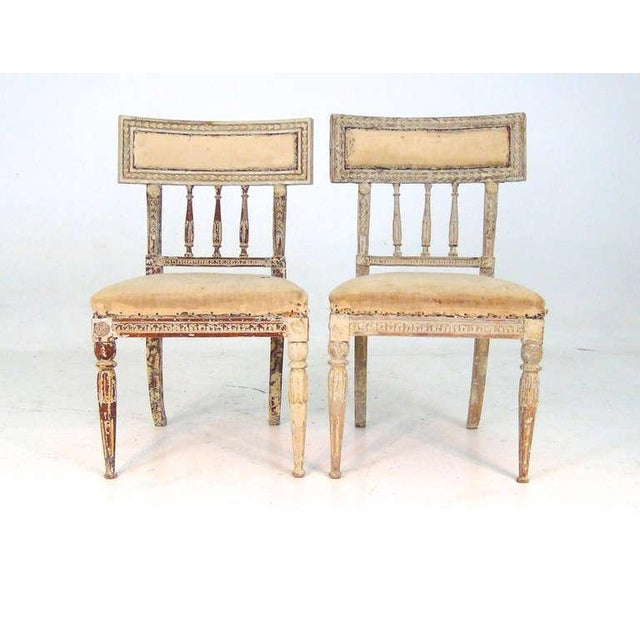 This pair of 19th Century Gustavian chairs have great detail to the wood frame, with a distressed white finish. The seats...
