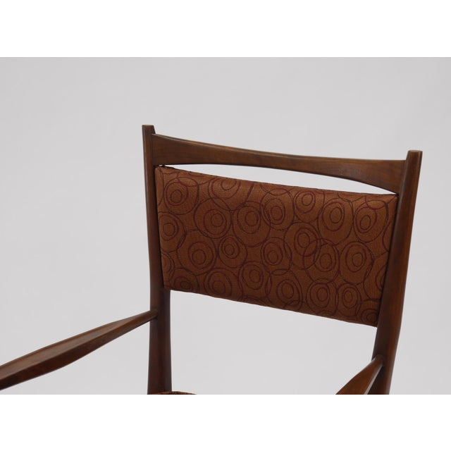 Eight Irwin collection dining chairs by Paul McCobb. Upholstered seats and backs. Good vintage condition. Walnut frames in...