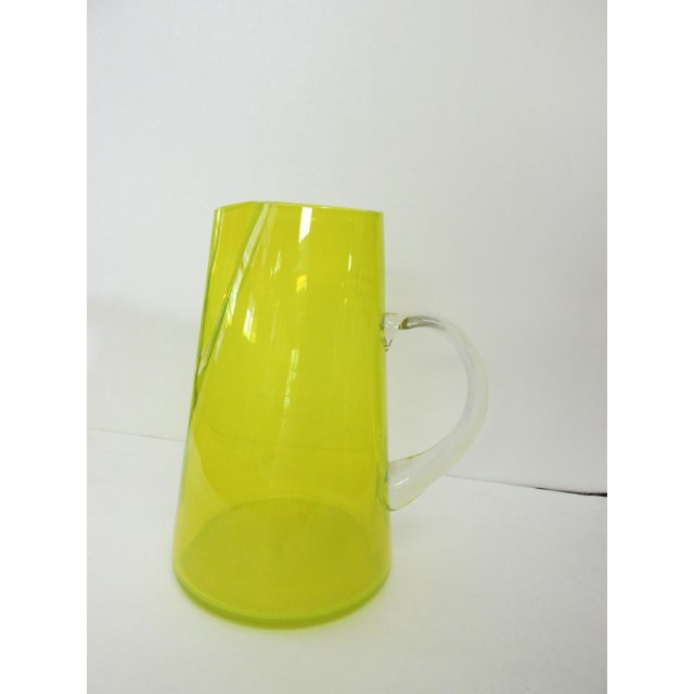 Mid-Century pitcher with a yellow glow. Hand-blown with an applied handle.