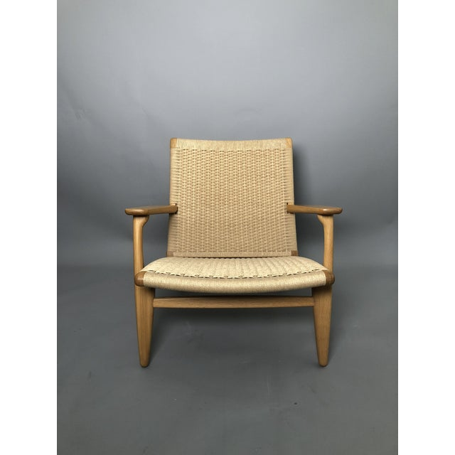 Hans Wegner Model CH25 oak lounge chair with handwoven paper cord seat and back for Carl Hansen & Son. Made in Denmark.