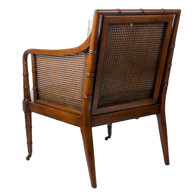 Vintage faux bamboo caned regency style club chair from the Hickory Chair Co. Comprised of bamboo turned frame with caned...