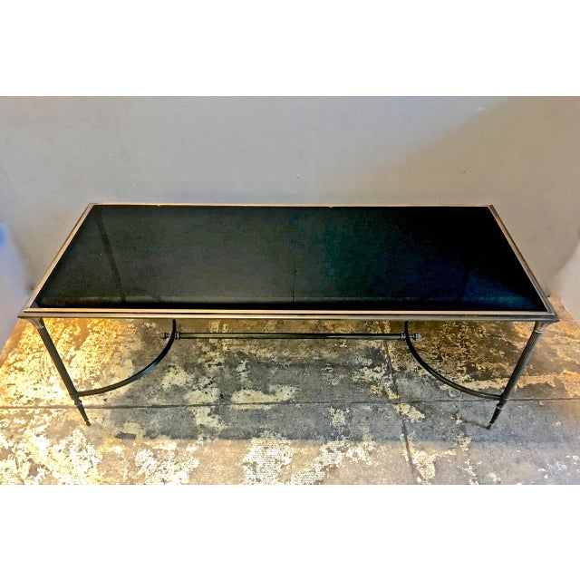 This is a great example of a Maison Bagues bronze and glass coffee table that dates to the 1950s. All elements of the...