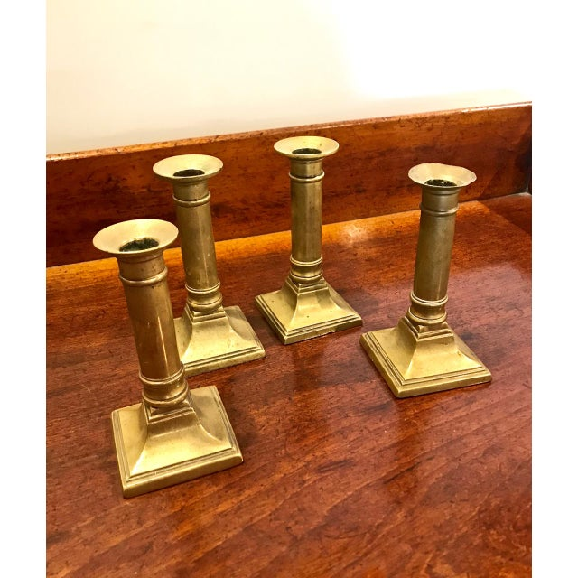 This a very decorative set of 4 (two almost identical pairs) of English 19th c. candlesticks of Regency style. All four...
