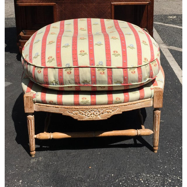 Large Regency Style Pink Striped Upholstered Ottoman. This lovely ottoman is genuine designer furniture. It features a...