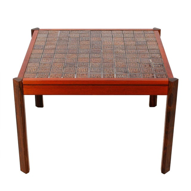 Here is an interesting Danish Modern table. The frame is light with contrasting darker legs. The top of the table is...