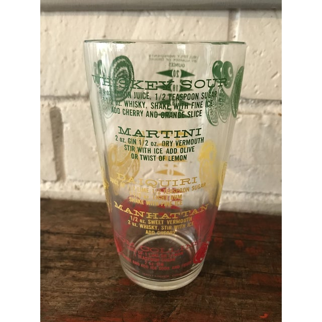Cool retro 1950's cocktail mixing glass with recipes and measurements in green, red and yellow. Marked Mr. Bartender...