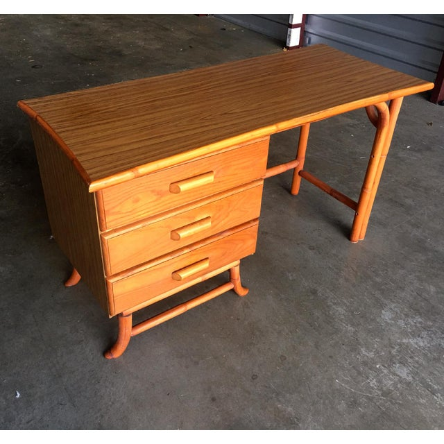 Vintage 1950-60s rattan desk with matching chair. Features unique atomic shaped top, 3 drawers on the left with rattan...