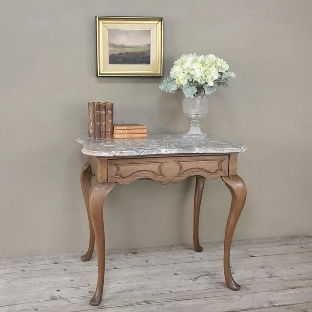 19th Century French Louis Philippe Walnut Marble Top Writing Table represents the epitome of the style, with boldly...
