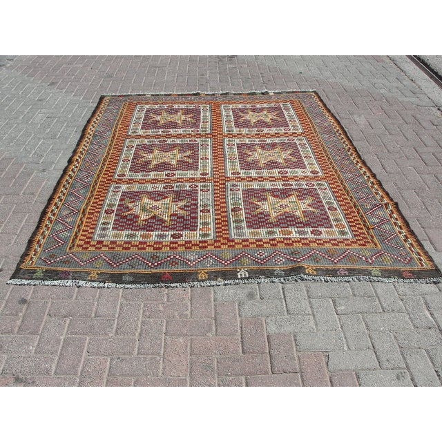 Vintage handwoven Turkish kilim rug. The kilim is nearly 60 years old. It is handmade of very fine quality natural wool in...