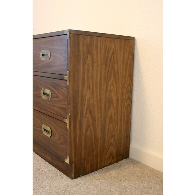 Lovely three (3) drawer campaign dresser chest for bedroom or entryway. Veneer with brass corners and hardware. Some...