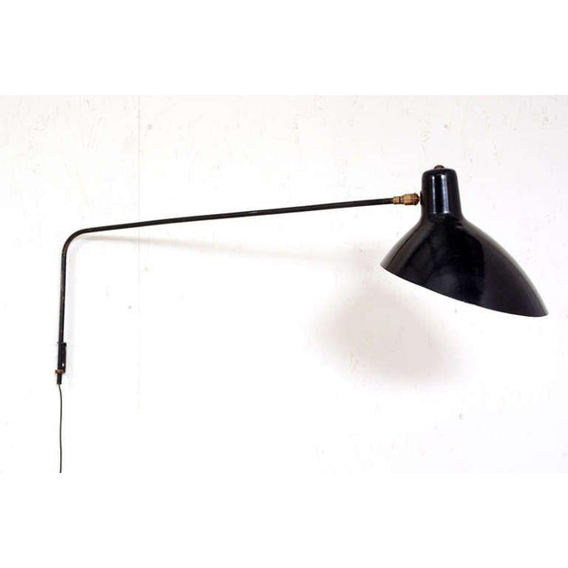For your consideration a vintage wall sconce by Vittoriano Vigano. Aluminum shade painted in black. Requires bayonet bulb....