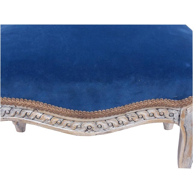 Romantic and elegant antique French Louis XVI footstool. Creamy white base with light gold accents, lightly distressed to...