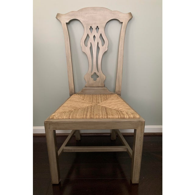 Designer English country dining chairs with hand woven rush seats from Furniture Classics. Beautiful faux finish in warm...