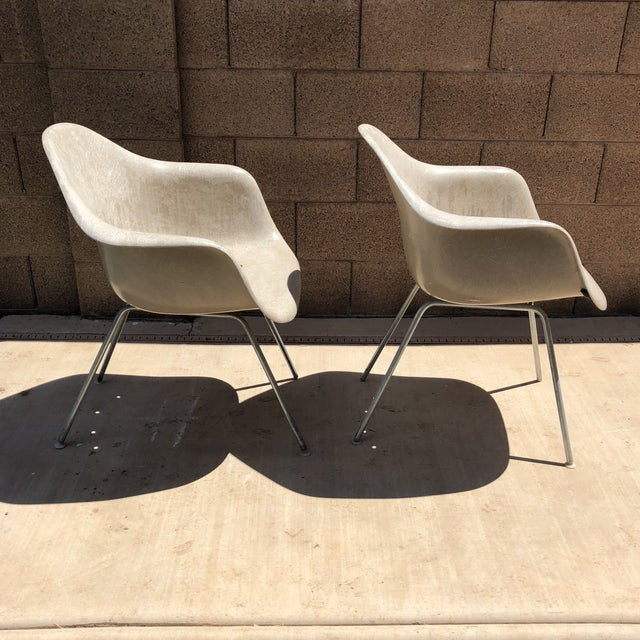 Pair of mid century modern shell chairs by Eames for Herman Miller.