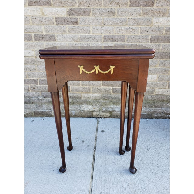 Small antique French Mahagony games or card table with flip top and hidden draw. The table has 5 Queen Ann style legs, the...