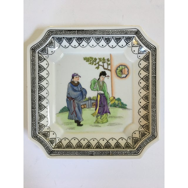 Offering a lovely hand painted Chinoiserie porcelain tray/catchall with clipped edges. There is a black decorative edging...