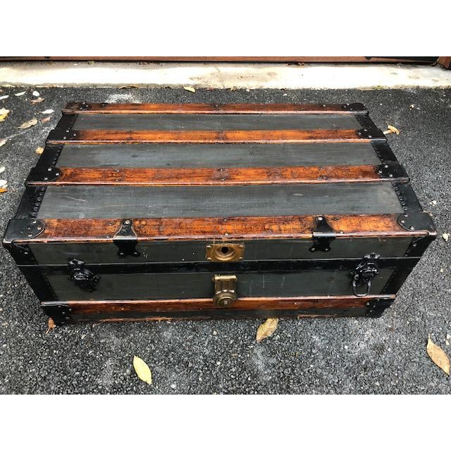 Late 1800s cloth covered travel trunk, embossed with initials and NY. Gorgeous wood lining and great iron detail.