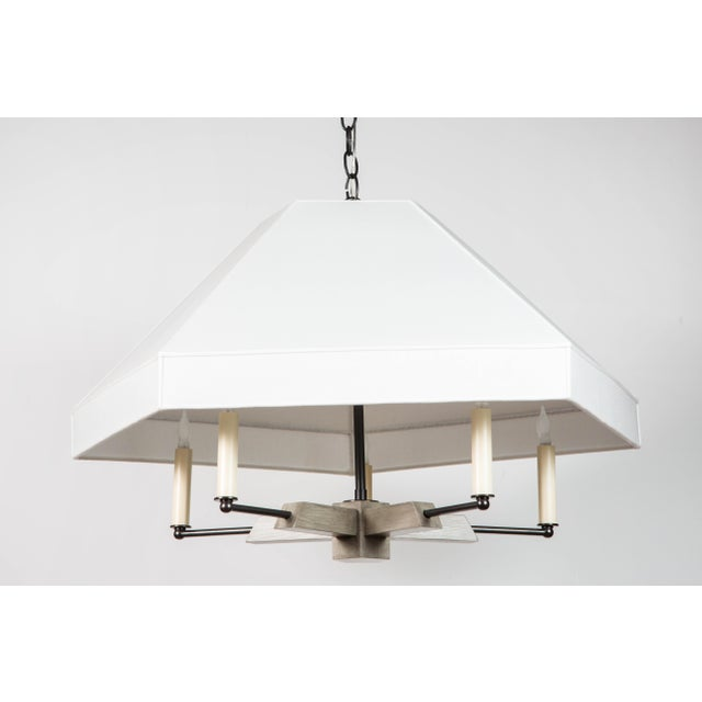Paul Marra Pentagon Fixture. Hand-made in oak and metal finished in oil rubbed bronze. One fixture is shown in a gray wash...