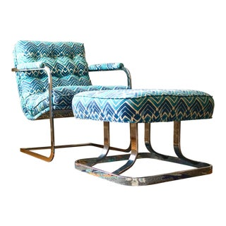 Carson's Mid-Century Modern Chrome Scoop Chair and Ottoman For Sale