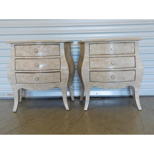 Pair of Maitland Smith side or end chests in tessellated tone with brass trim and accents. Tessellated stone gives these a...