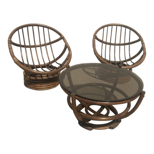 Vintage 60s Rattan Papasan Swivel Rocking Chairs & Table - Set of 3 For Sale