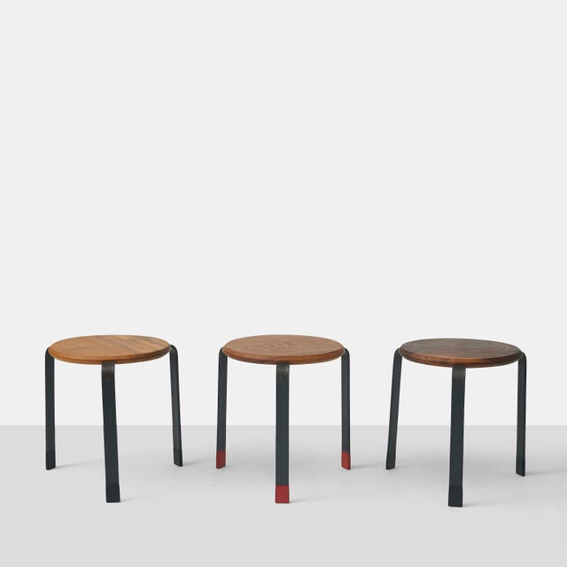 Low stacking stools, designed and manufactured in San Francisco by Josh Duthie. features a wooden seat and rubber bottom...