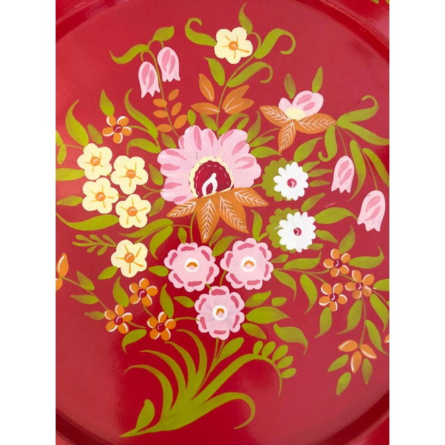 Large and beautiful painted metal tray. Vivid colors and generous size. Useful and decorative.